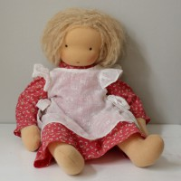 Waldorf doll girl in red dress and white apron, blond hair, made by feinslieb