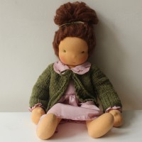 Waldorf doll girl in pink dresss, brown hair, green hand-knitted cardigan, made by feinslieb