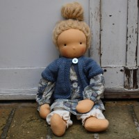 Waldorf doll girl in liberty dress, blueish cardigan, blond hair, made by feinslieb