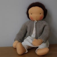 Waldorf doll girl in white dress and beige cardigan, dark brown hair, made by feinslieb