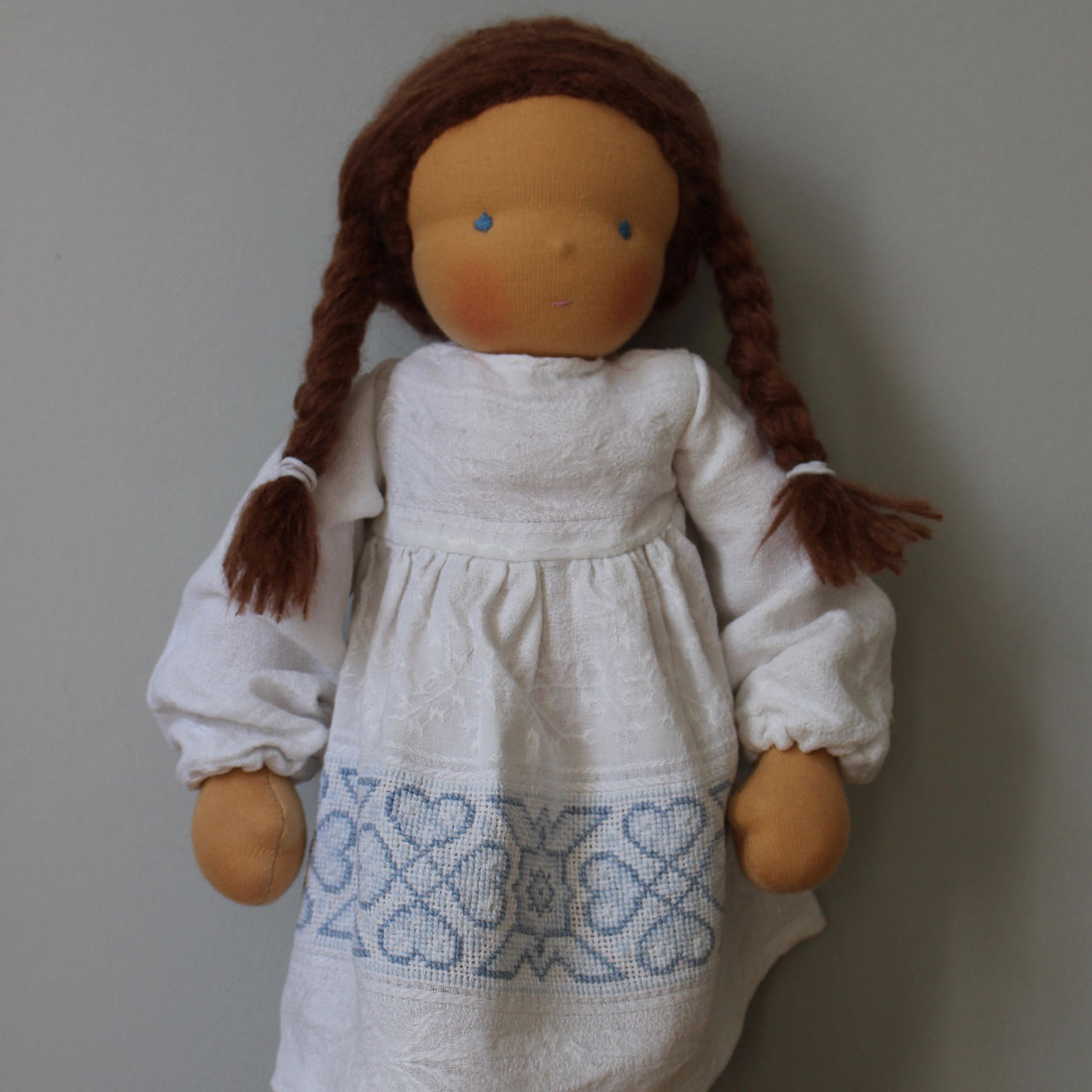 Waldorf doll girl in white embroidered dress, brown hair, made by feinslieb