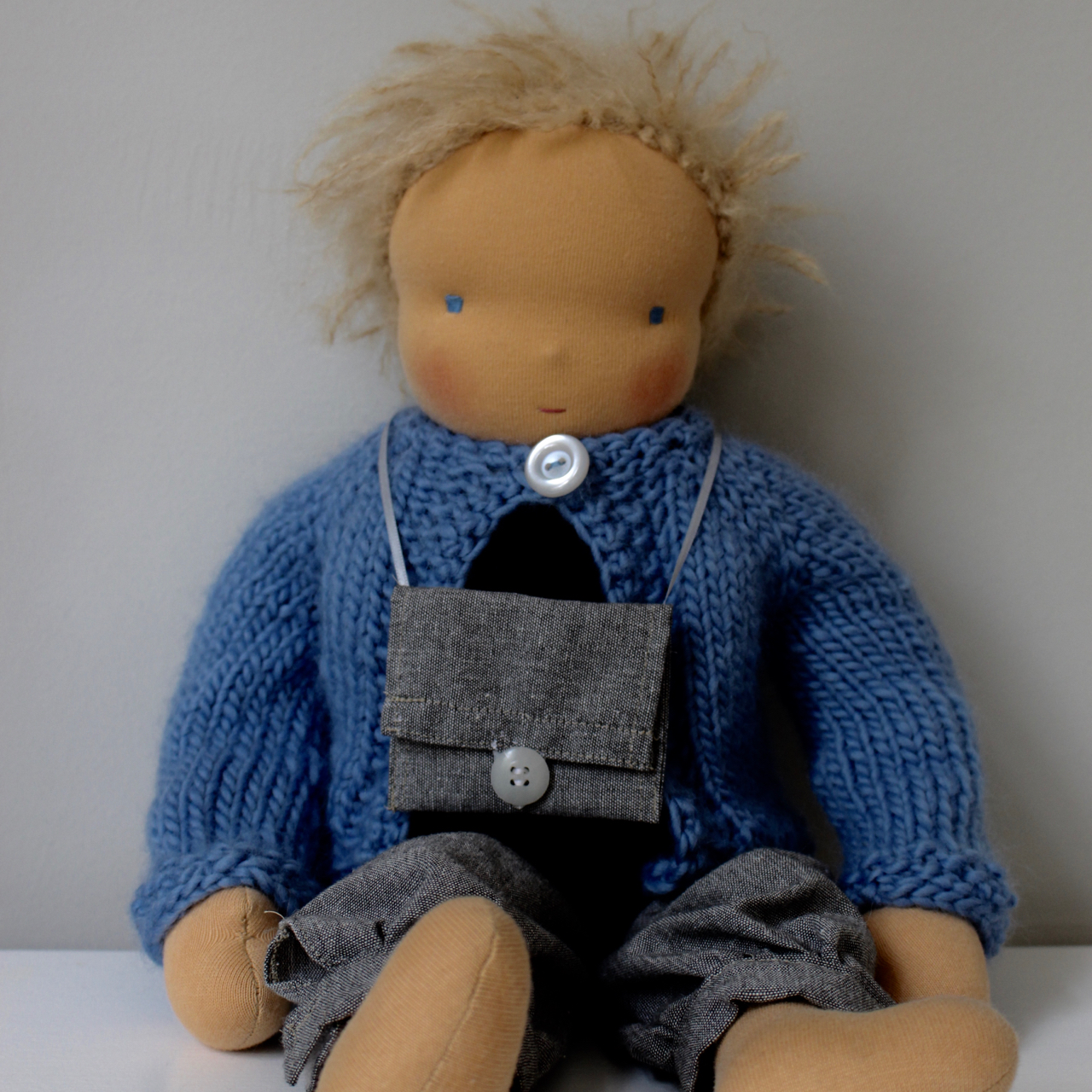 Waldorf doll boy, blond hair, with light blue hand-knitted cardigan and trousers, made by feinslieb