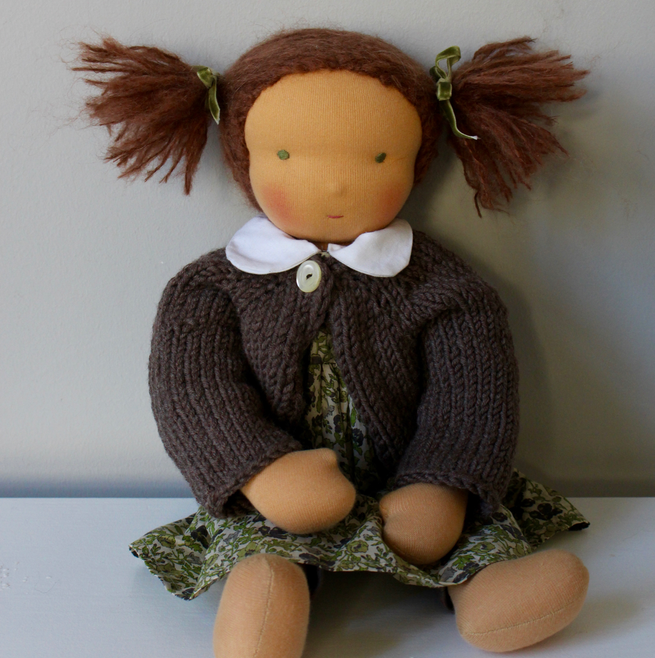 Waldorf doll girl in greenish liberty dresss, brown hair, made by feinslieb