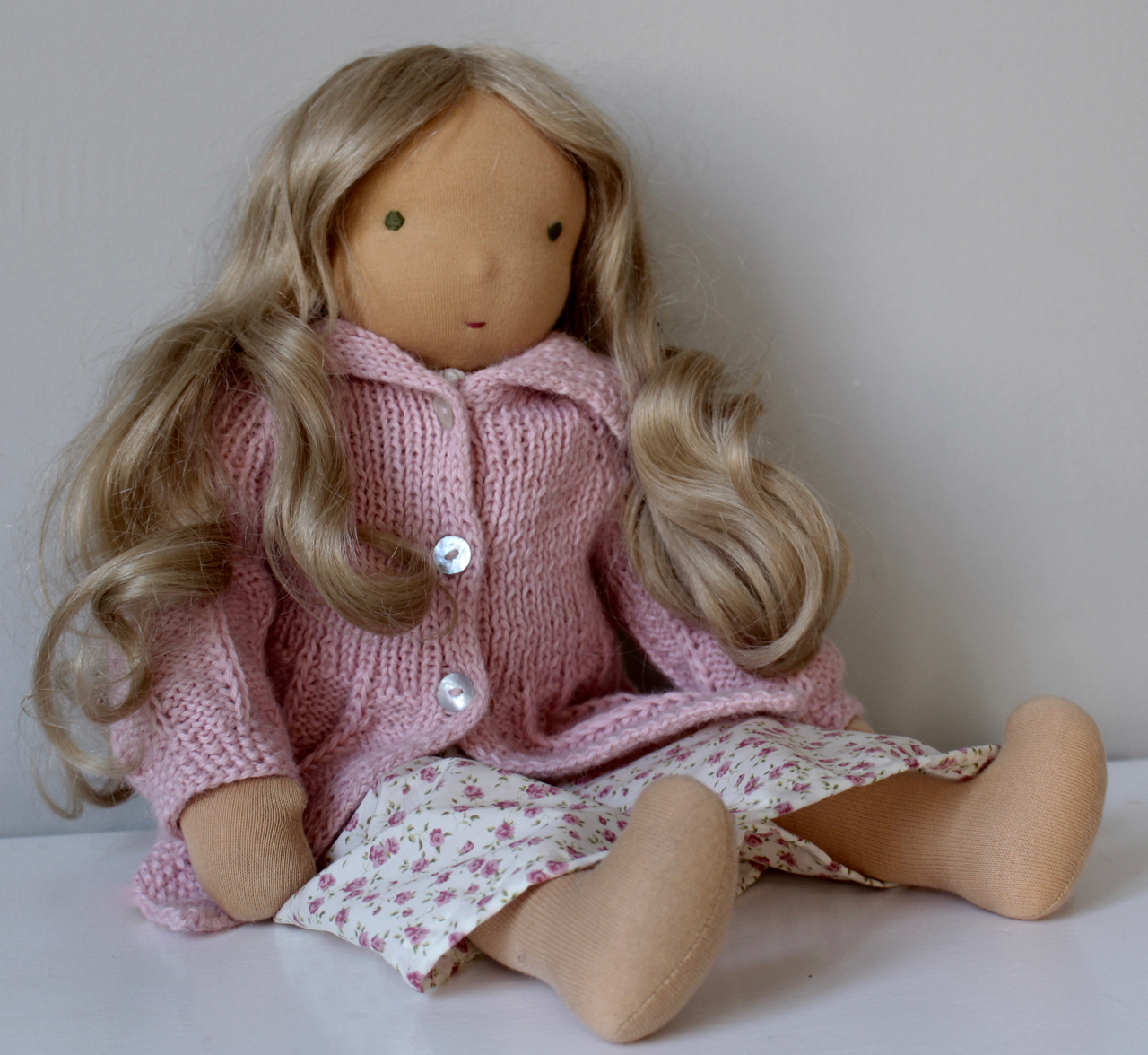 Waldorf doll with human hair and pink cardigan