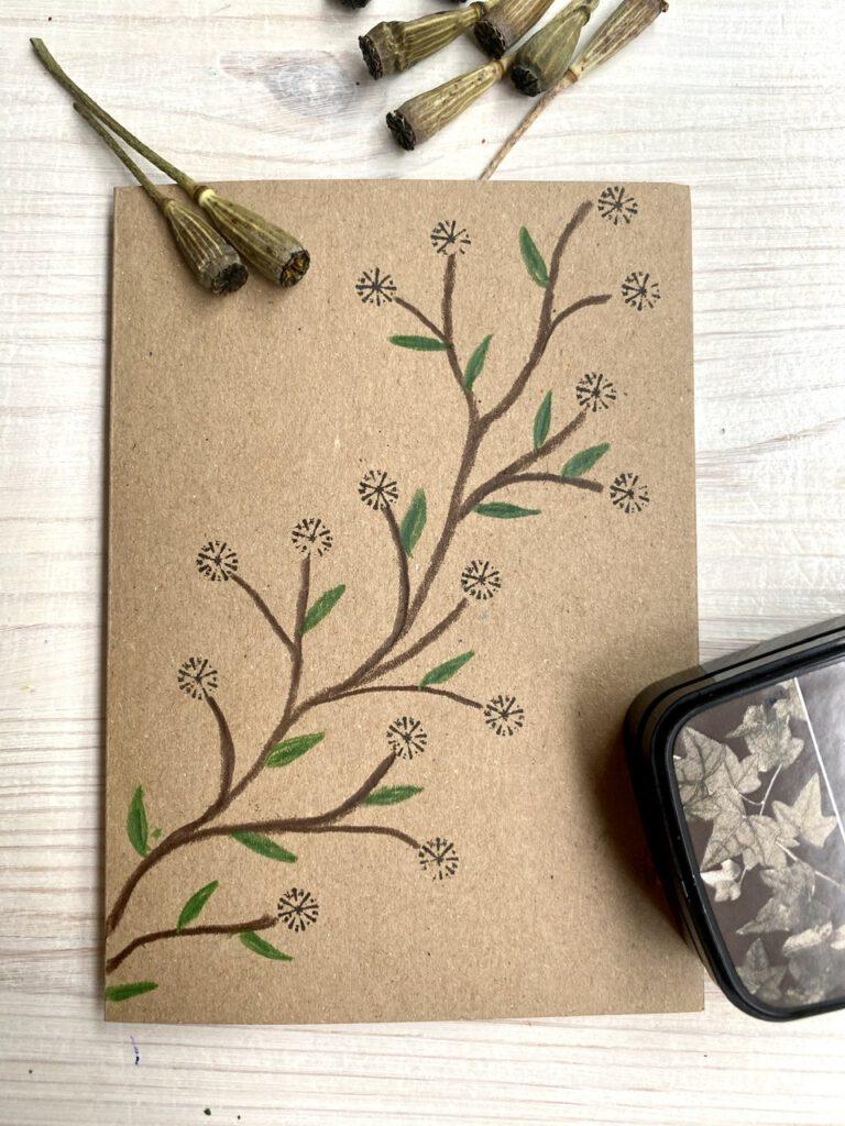 Blütenranke aus Stempeln mit Mohnkapseln
