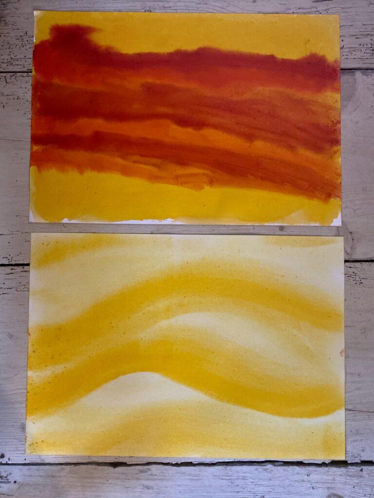 Waldorflaterne, Schritt 1: Bemaltes Aquarellpapier auf dem Holzboden