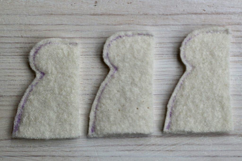 Ausgeschnittene Mäntelchen von links